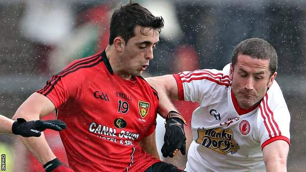 Down's Ryan Johnston in action against Stephen O'Neill