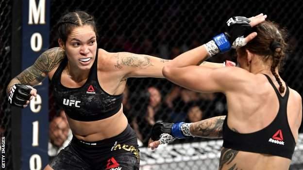 Amanda Nunes of Brazil strikes Germaine de Randamie of Netherlands