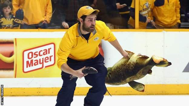 Predators ice crew member clearing catfish