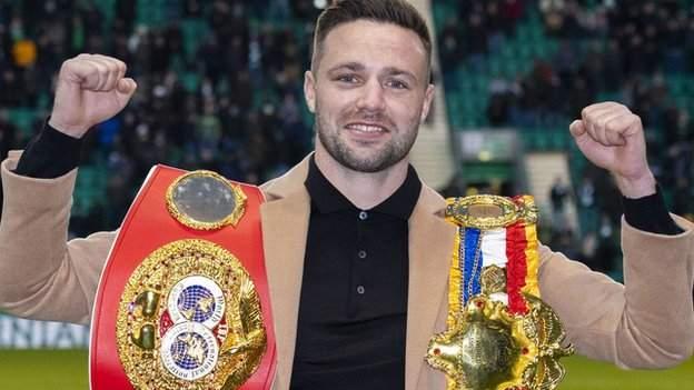 Scotland's world champion Josh Taylor celebrating with his belts