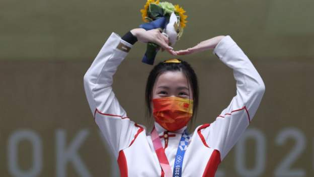 Masked anthems and medals served on trays - Chinas Yang wins first gold of Games