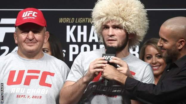 Khabib Nurmagomedov and his father and coach Abdulmanap Nurmagomedov at a weigh-in ceremony before his fight with Dustin Poirier at UFC 242