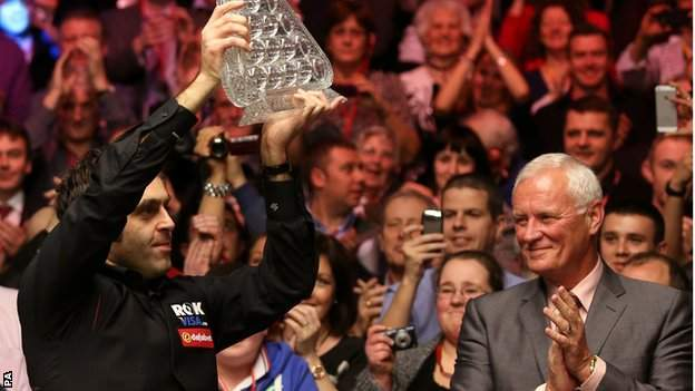 Ronnie O'Sullivan celebrates his 2014 Masters success with Barry Hearn joining in the applause
