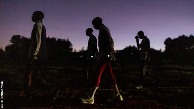 animals Kipchoge and other runners gather in the early morning half-light
