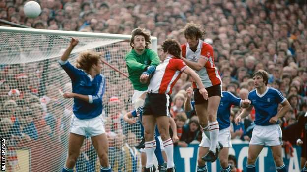 Southampton striker Kevin Keegan (c) beats fellow saint Mick Channon and Birmingham City goalkeeper Jeff Wealands to head in the 3rd goal in a 3-1 First Divison win over Birmingham City at the Dell on August 30, 1980