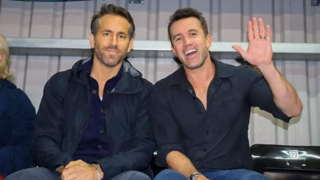 Hollywood co-owners Ryan Reynolds and Rob McElhenney attend first Wrexham game