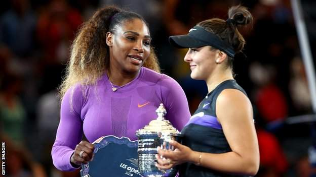 Serena Williams speaks to Bianca Andreescu on the US Open podium