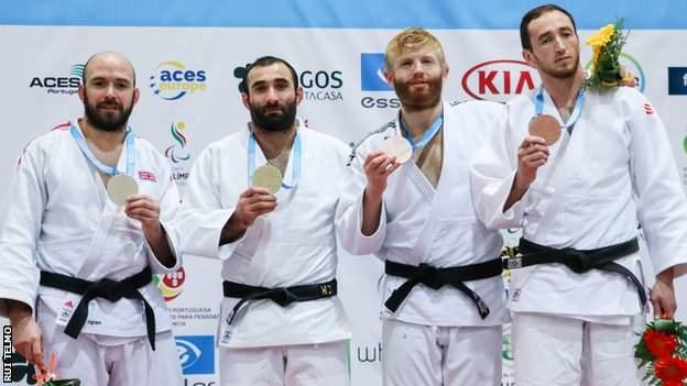 Sam Ingram and Chris Skelley on the -100kg podium at the IBSA Judo World Championships