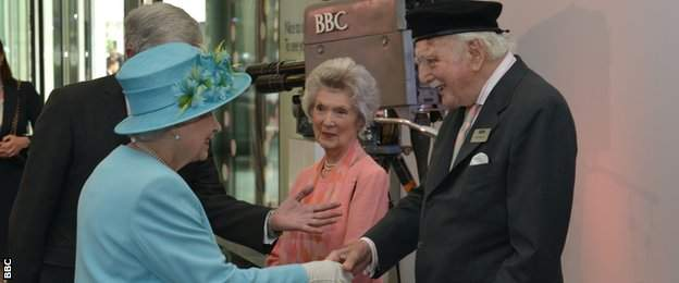 Peter Dimmock shaking hands with the Queen