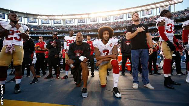 Colin Kaepernick kneels during the national anthem
