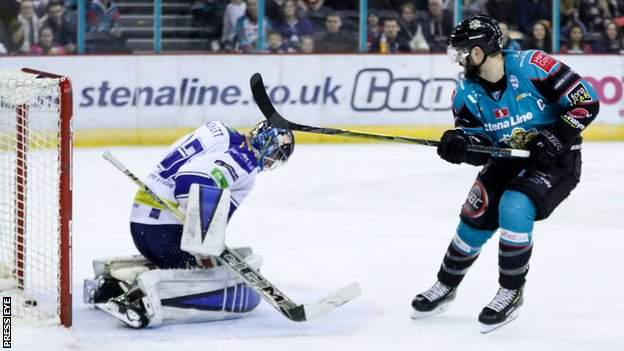 Belfast Giants' Blair Riley scoring against Coventry Blaze's Matt Hackett