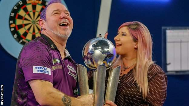 Peter and Jo Wright with the PDC World Championship trophy