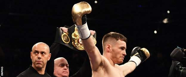 Ryan Burnett celebrates his victory as his trainer Adam Booth (left) looks to his right