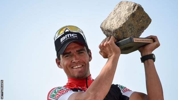 Belgium's Greg van Avermaet hold up the cobbled trophy for winning Paris-Roubaix 2017
