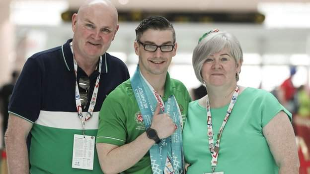 Patrick Quinlivan with his parents after winning a remarkable seven medals on Sunday