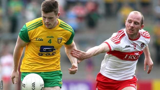 Donegal defender Eoghan Ban Gallagher gets a tug from Derry's Sean Leo McGoldrick at Celtic Park