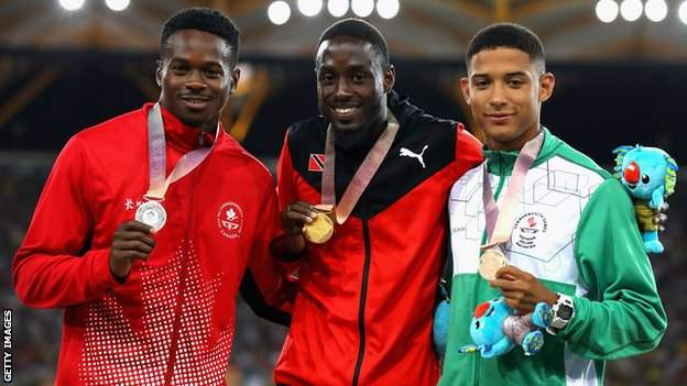 Leon Reid (right) alongside Canada's Aaron Brown and Trinidad & Tobago's gold medallist Hereem Richards on the Commonwealth Games podium