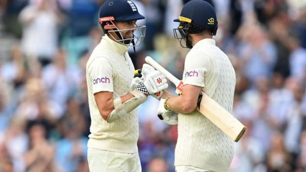 England v India: Ollie Pope and Chris Woakes star on hard-fought day