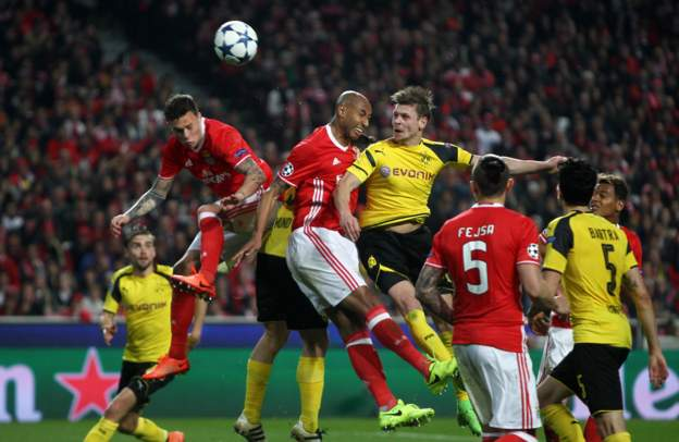Lukasz Piszczek heads towards goal