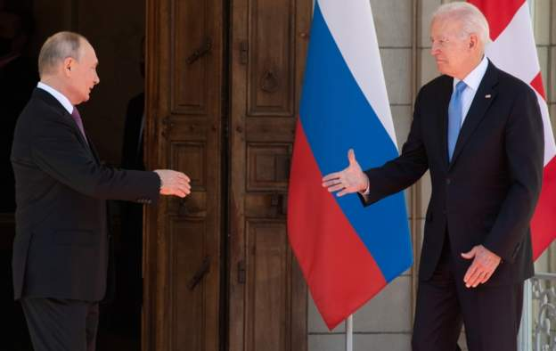 U.S. president Joe Biden offers his hand first and his Russian counterpart Vladimir Putin is seen having to step forward to shake his hand.