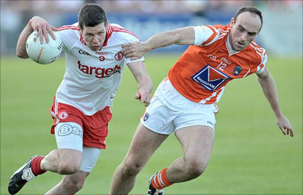 Sean Cavanagh of Tyrone in action against Armagh's Michael O'Rourke
