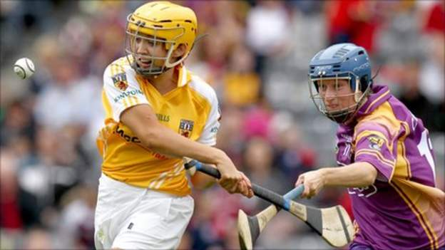Antrim's Aileen Martin is challenged by Wexford opponent Bridget Curran at Croke Park