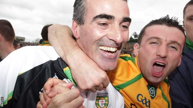 Jim McGuinness is embraced by Donegal fans after the county's Ulster Final triumph