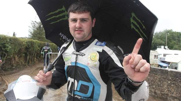 Michael Dunlop celebrates his victories at a rainy Armoy
