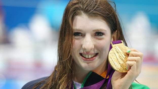 Bethany Firth celebrates with her gold medal