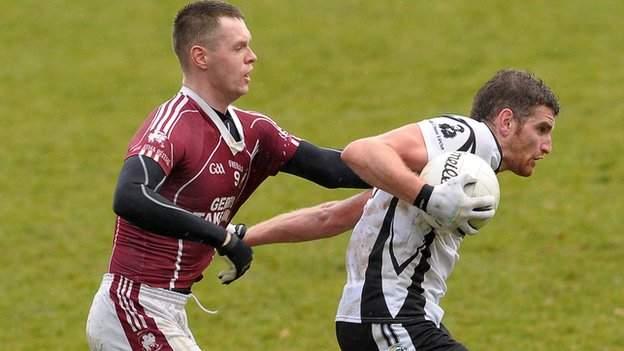 Ballybay's Tommy O'Neill gets a grip on Paul Greenan