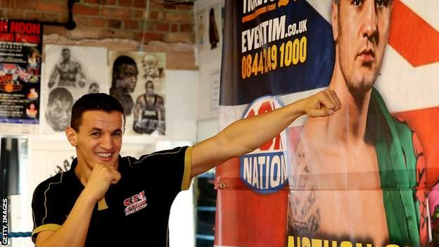 Robin Krasniqi spars with a poster of Nathan Cleverly.