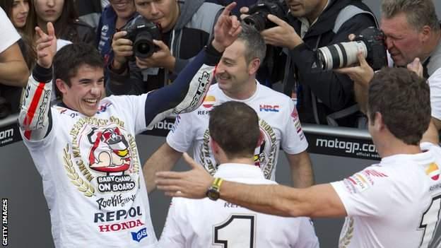 Marc Marquez celebrates winning MotoGP title