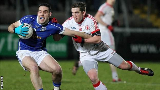 Cavan's Eugene Keating battles with Tyrone's Dermot Carlin in this year's McKenna Cup final
