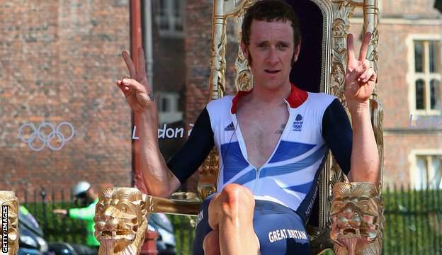 Bradley Wiggins sits on a gold throne as he celebrates his time trial victory in the 2012 Olympics