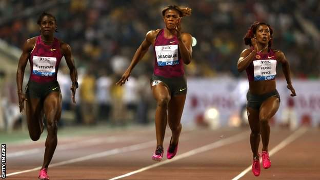Shelly-Ann Fraser-Price (right) wins the women's 100m at the 2014 Doha Diamond League meet