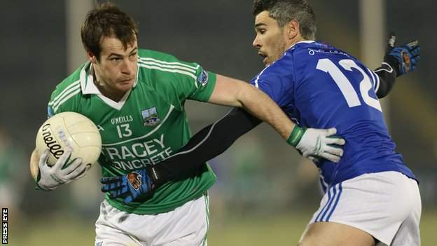 Fermanagh forward Ruairi Corrigan is tackled by Cavan's Mark McKeever in the semi-final
