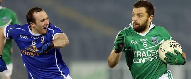 Cavan's Fergal Flanagan gives chase to Fermanagh defender Ryan McCluskey at Brewster Park