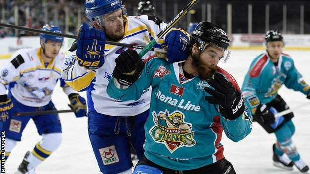 Fife's Chris Wands puts in a strong challenge on Belfast forward Darryl Lloyd