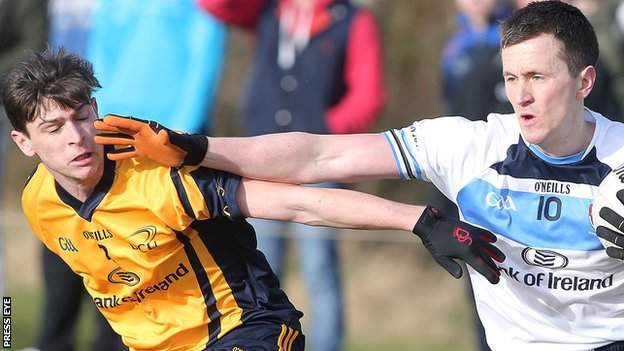 DCU's Sean McGabhainn competes with Cillian O'Connor of UUJ