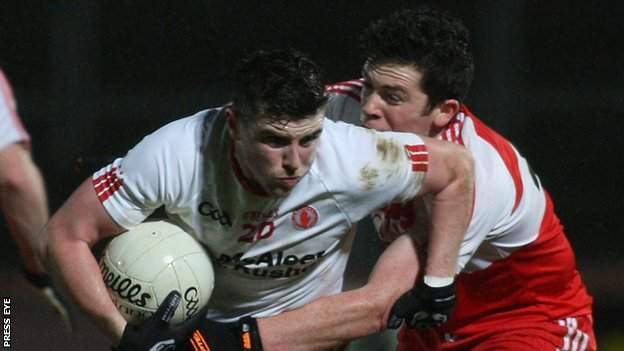 Tyrone's Connor McAliskey attempts to break away from Derry's Dermot McBride at Healy Park