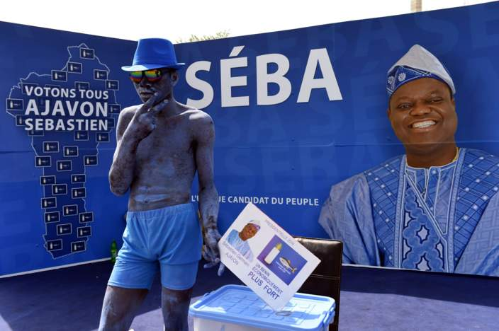 A comedian stands in the campaign stand of presidential candidate and food magnate Sebastien Ajavon on March 3, 2016, in Cotonou. Benin