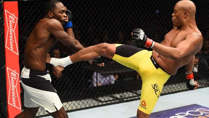 Anderson Silva lands a kick to Derek Brunson at UFC 208