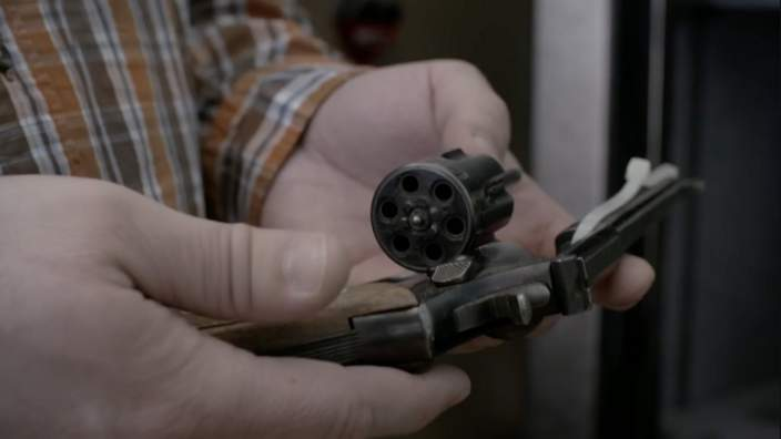 Nathon's father holds the gun used to shoot himself and his wife.
