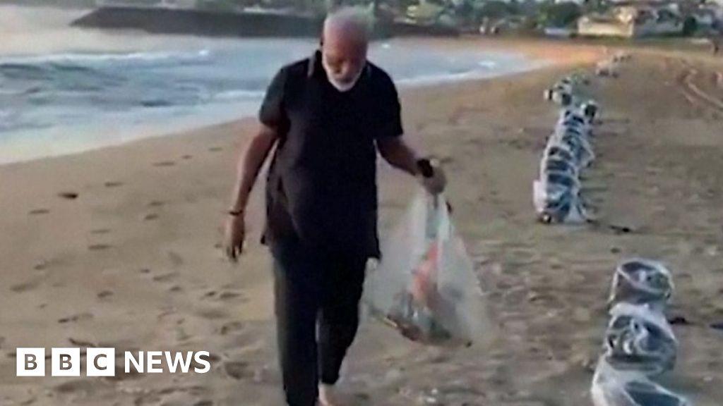 India's Narendra Modi's litter picking 'plog' on beach