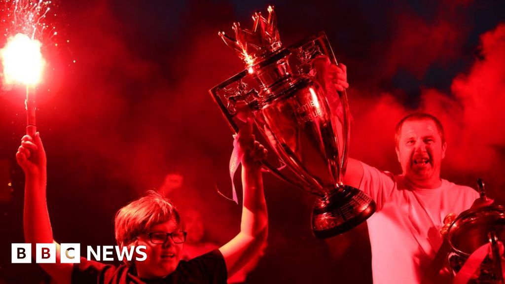 Liverpool fans flock to Anfield to celebrate Premier League title