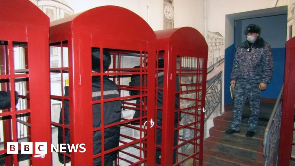 Prisoners use British red phones in a Russian prison