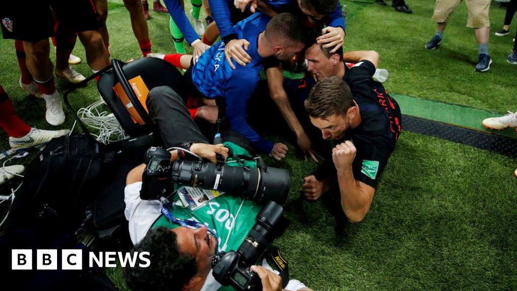 Lensman caught in Croatia victory pile