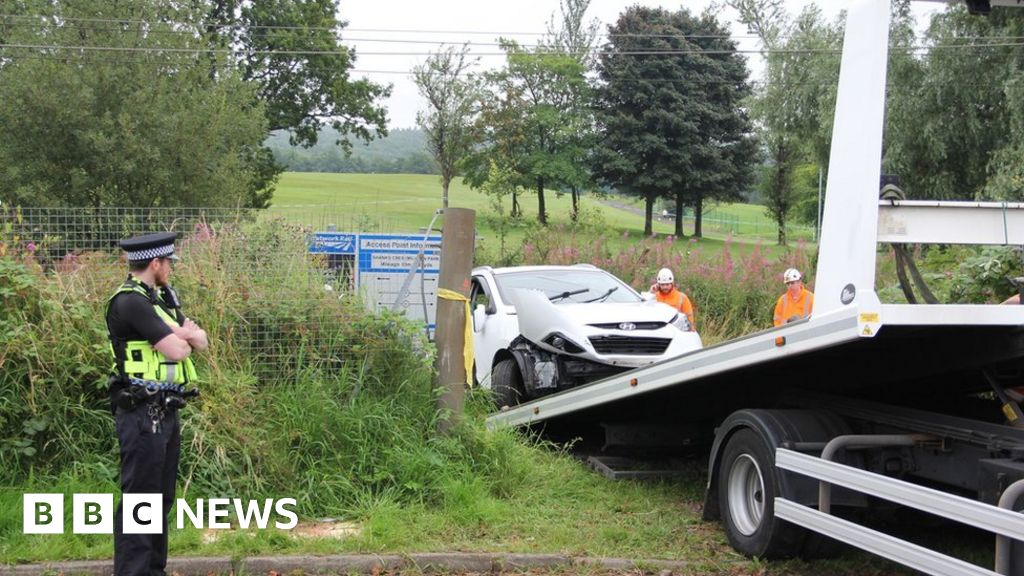 Driver hurt after train collides with car in Johnstone
