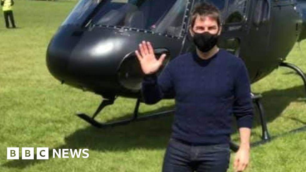 Covid: Tom Cruise signs shirts for football club on movie set