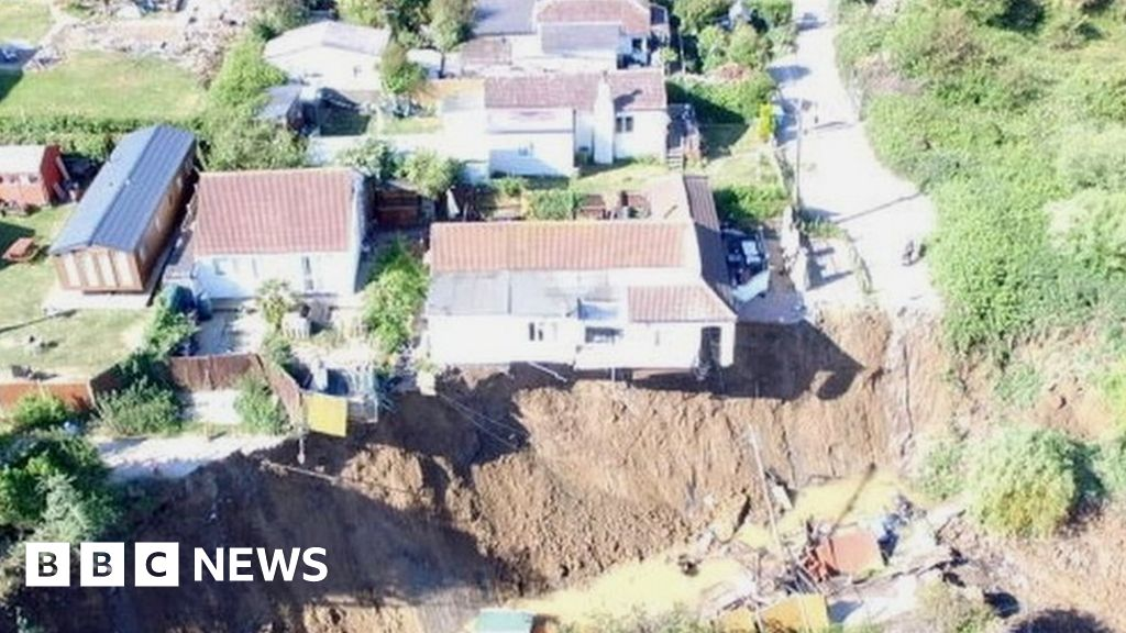 Eastchurch cliff fall: House hanging over edge after second collapse thumbnail